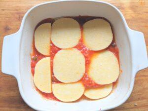 Polenta slices in tomato sauce